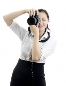Woman taking a picture to get free images to use in your WordPress blog